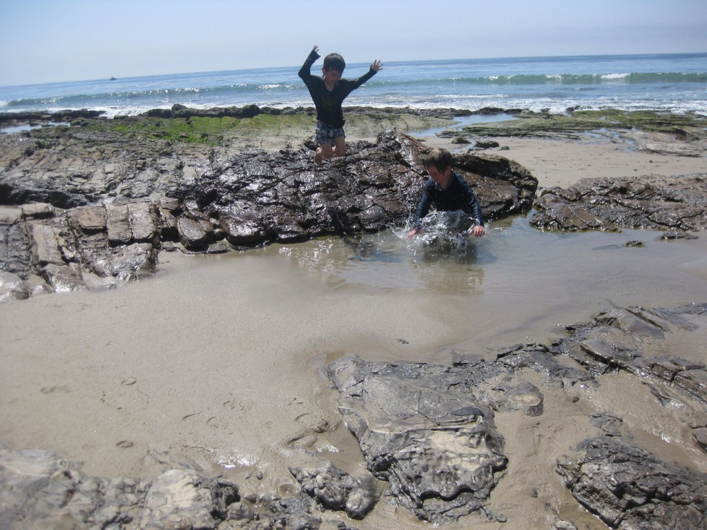Leaping into tide pools at Crystal Cove.