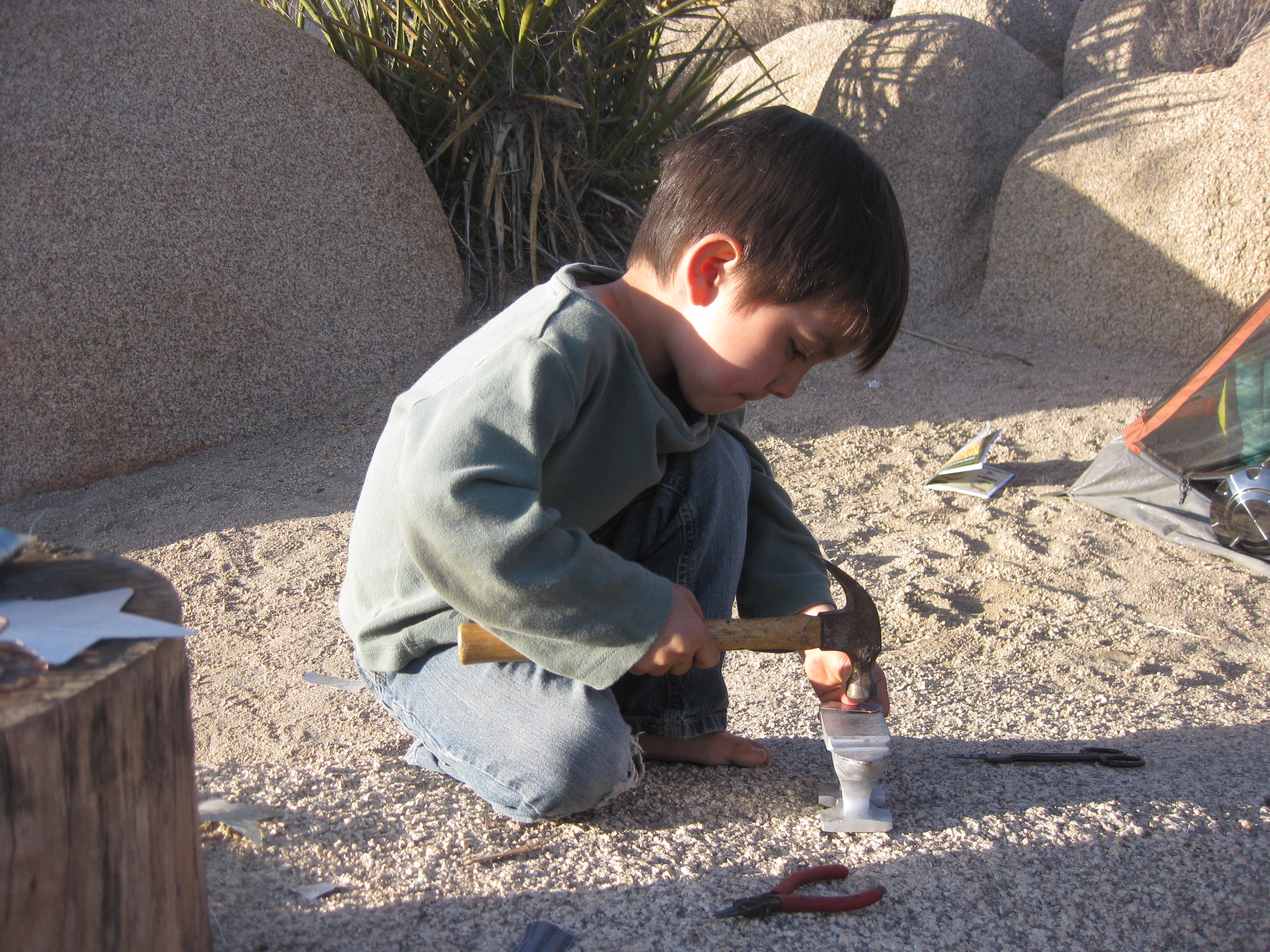 Metal-working while camping in Joshua Tree. Hammering with a real hammer is something you enjoy.